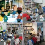 Czterolatki z Oddziału przy SP Raszyn oglądają książki o tematyce świątecznej